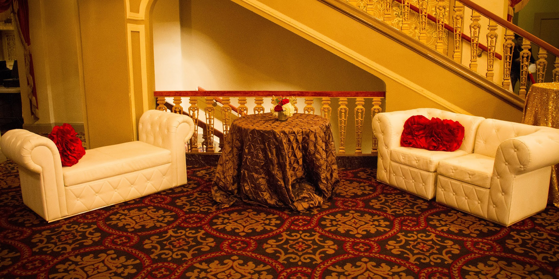 White couches with red pillows in grand lobby