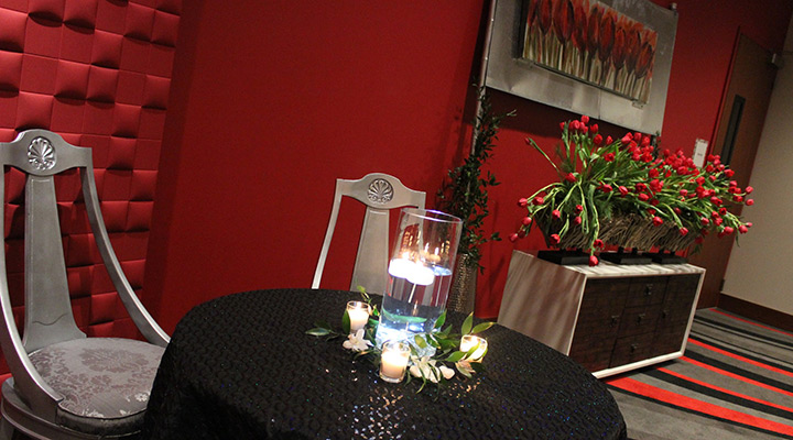 Table and chairs with candle centerpiece