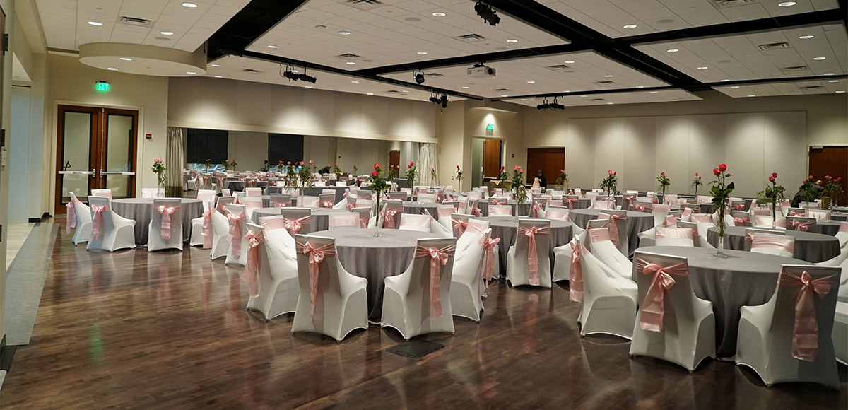 White tables and chairs in Reception hall