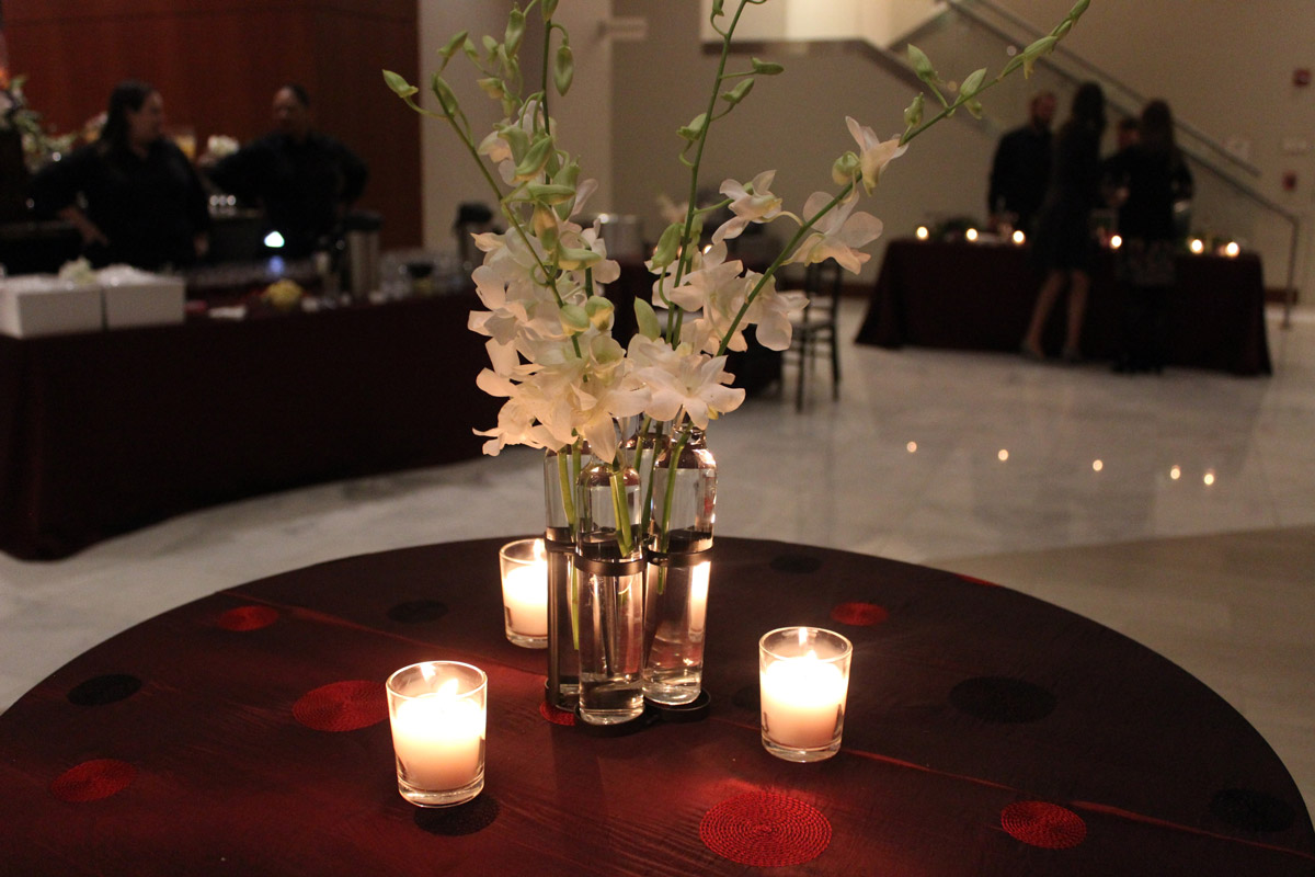 White flower centerpiece with candles