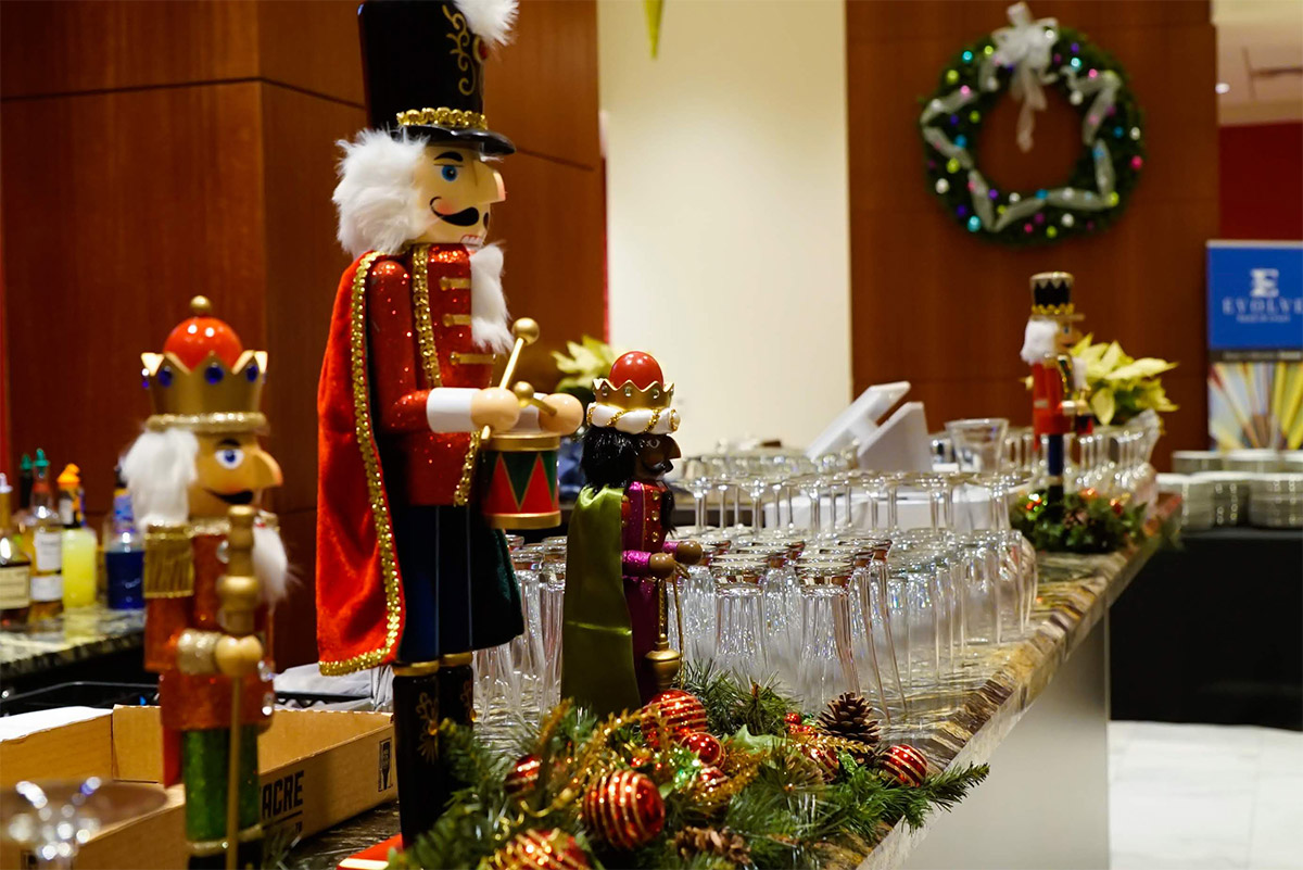 Glasses and Nutcracker lined up on Halloran Centre bar